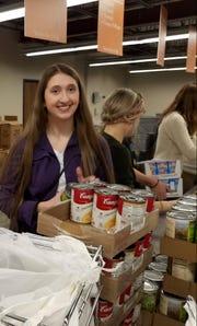 Baltic student Kendra Kappler volunteers at Feeding South Dakota in Sioux Falls on Tuesday, Feb. 26.