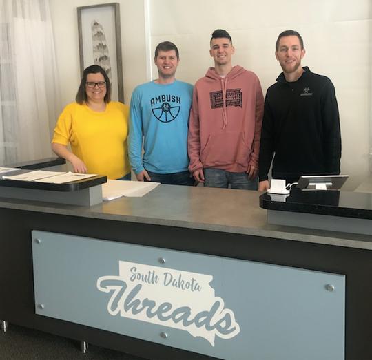 The staff at South Dakota Threads (l-r) Jessica Johnson, Cory Jacobsen, Trae VandenBerg, Garrett Callahan.