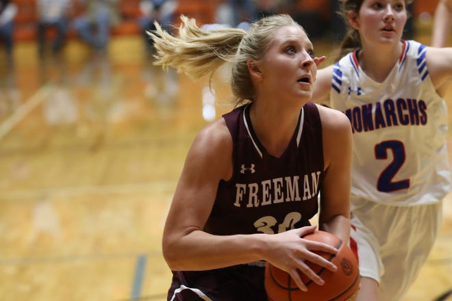 Freeman's Hannah Eberts drives towards the basket against Warner in the Class B quarterfinals on Thursday, March 7 in Huron.