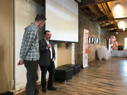 Sioux Falls entrepreneur Matt Paulson introduces 1 Million Cups keynote speaker Andy Traub on Wednesday at the discussion series' five-year anniversary event.