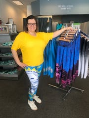 South Dakota Threads manager Jessica Johnson wears a pair of the South Dakota state flag yoga pants featured at the store.