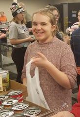Baltic student Ella Branham volunteers at Feeding South Dakota in Sioux Falls on Tuesday, Feb. 26.