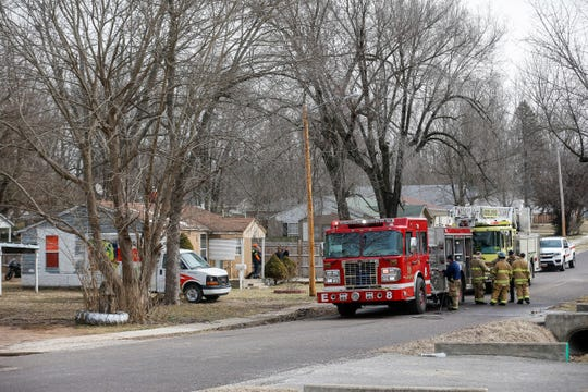 Firefighters work at the scene of the fire on the 2900 block of West Elm Street that killed Mackie on March 7.
