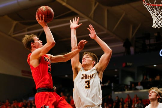 Republic's Tucker Thomas goes up for a basket as Kickapoo's David Senn attempts to block the shot during Class 5 sectionals at the O'Reilly Family Event Center on Wednesday, March 6, 2019.