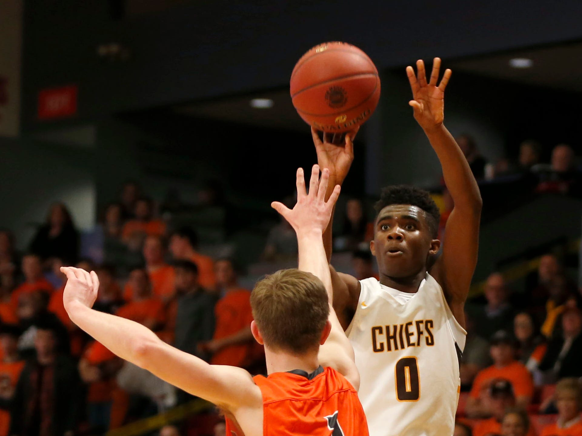 Kickapoo Chief Anton Brookshire shoots a field goal over Republic's Race Looney during Class 5 sectionals at the O'Reilly Family Event Center on Wednesday, March 6, 2019.