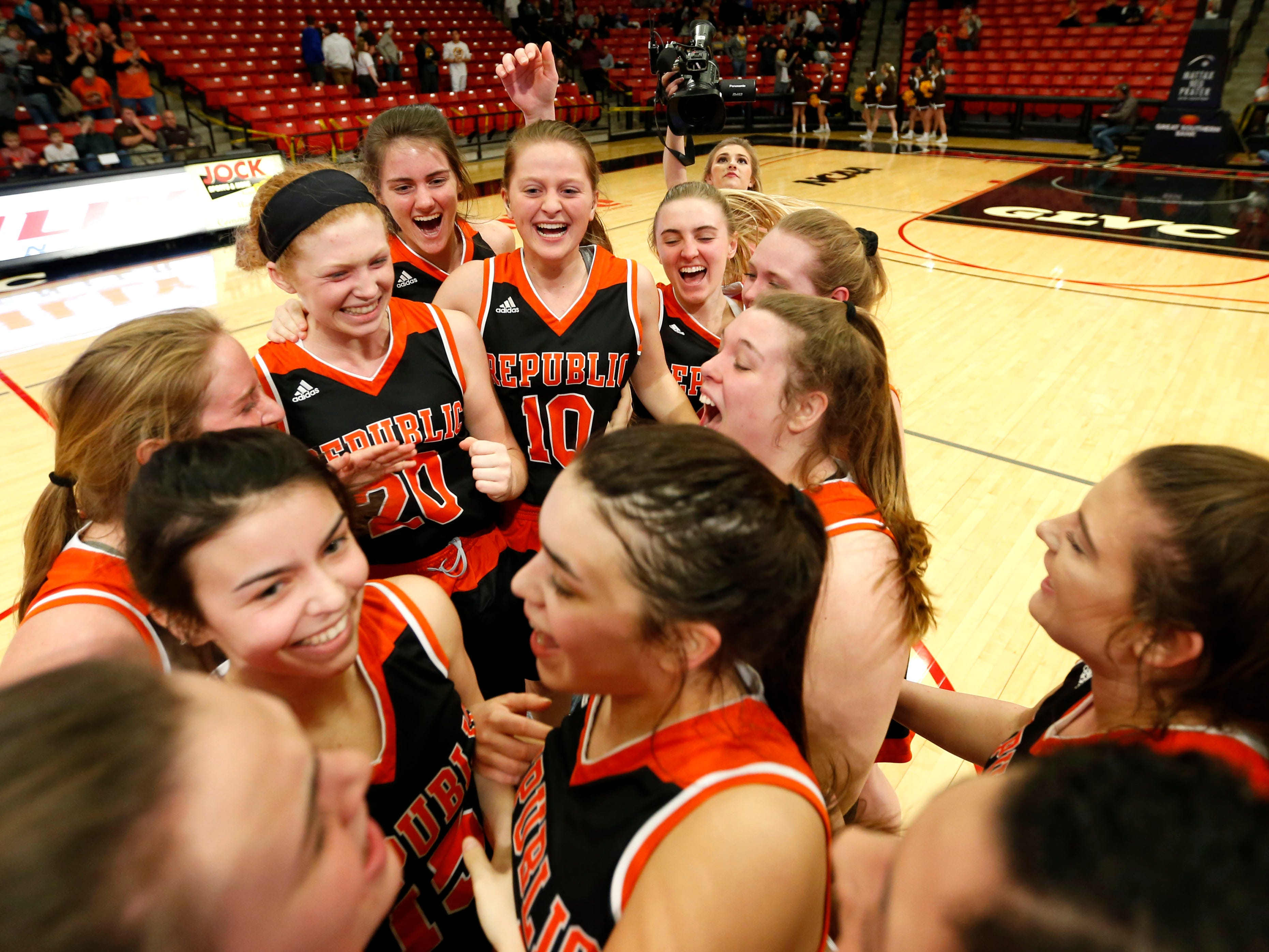 The Republic Lady Tigers celebrate after beating the Kickapoo Lady Chiefs during class 5 sectionals at the O'Reilly Family Event Center on Wednesday, March 6, 2019