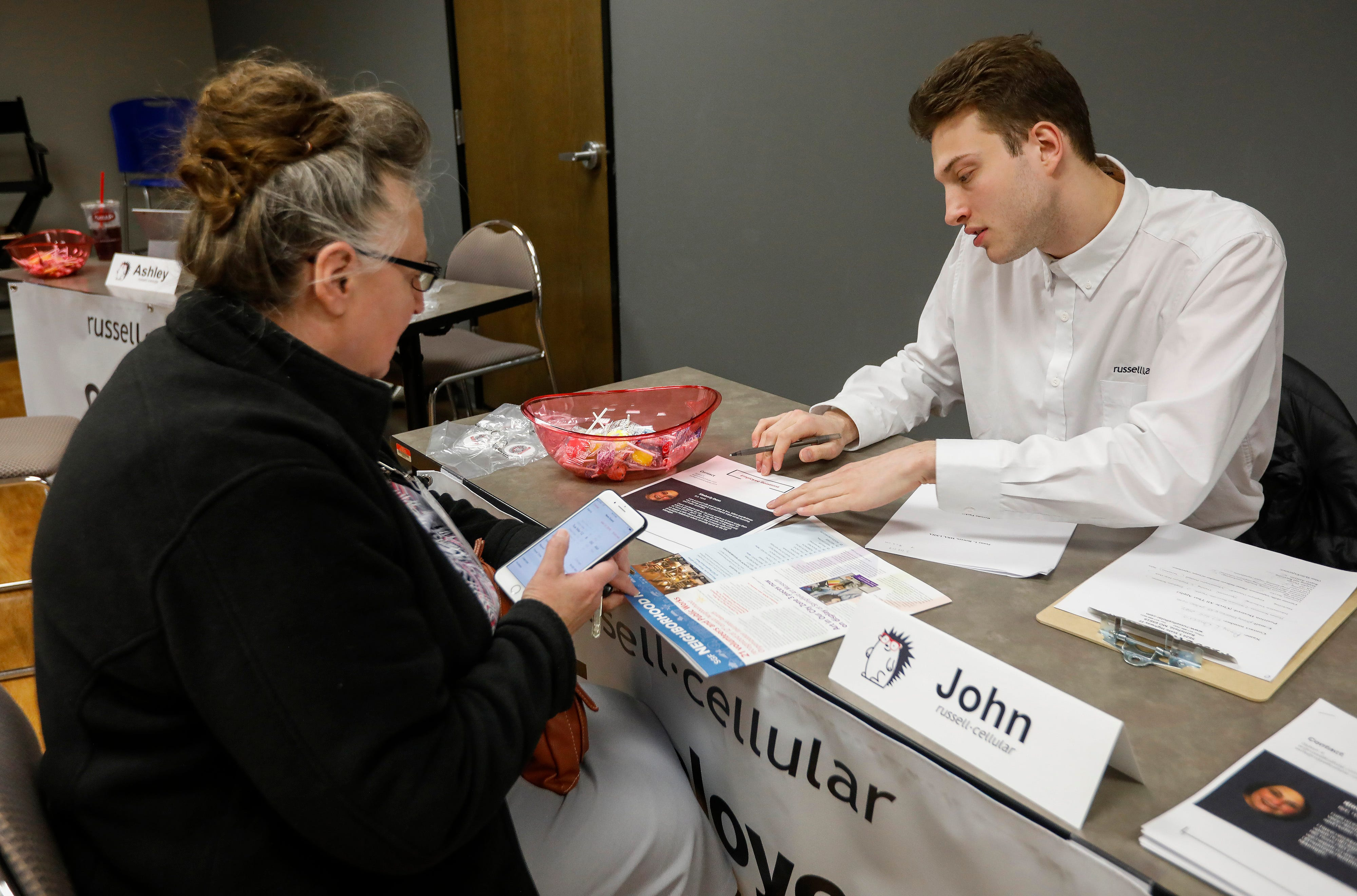 Penny Bowers, of Springfield, speaks with John Bogue, of Russell-Cellular, during a hiring event at the Missouri Career Center on Thursday, March 7, 2019.