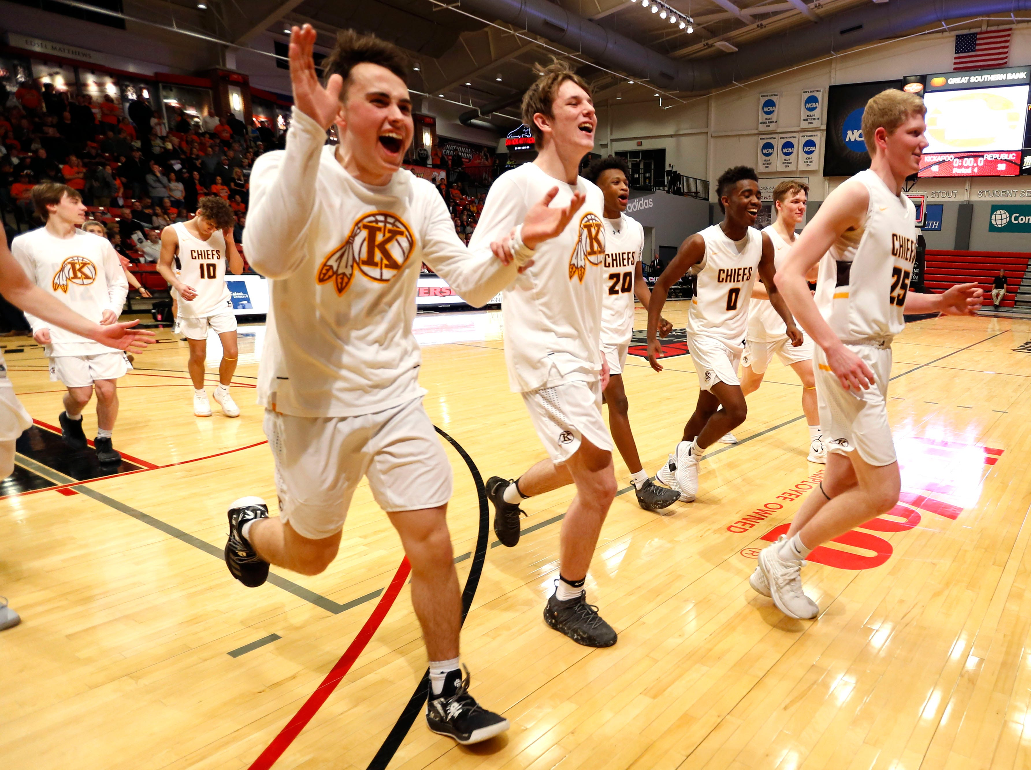 The Kickapoo Chiefs celebrate after they beat the Republic Tigers during class 5 sectionals at the O'Reilly Family Event Center on Wednesday, March 6, 2019.