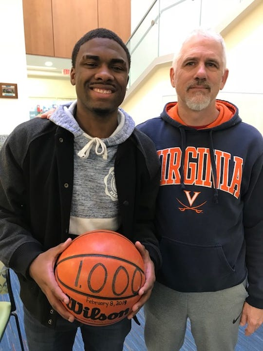 VSDB's Tishawn Manning, who scored over 1,000 points in his high school career, and his former basketball coach, Cliff Watson.