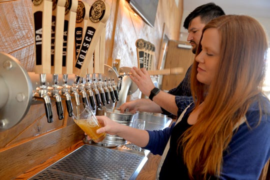 Taproom manager Claire Casto pours beer at Skipping Rock Beer Company. It is located outside of Staunton near Swoope will open March 15. It is the newest craft brewery in the Staunton, Augusta County and Waynesboro area.