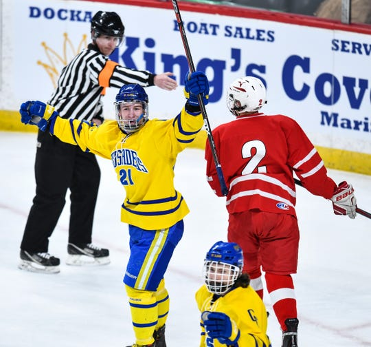 Cathedral's Luke Schmidt celebrates one of his two goals during the Minnesota Boy's Hockey Tournament Class A quarterfinals Wednesday, March 6, at the Xcel Energy Center in St. Paul.