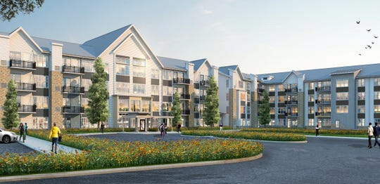 A four-story, 144-unit apartment building will be part of the Bluffs at Liberty Glen affordable housing community.