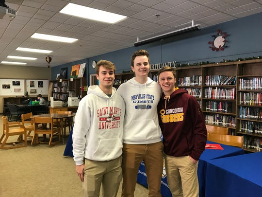 Cathedral seniors (from left) Sam Schneider (St. Mary's baseball), Nick Schaefer (Mayville State basketball) and Jackson Jangula (Concordia-Moorhead basketball) participated in a signing ceremony Thursday at Cathedral.