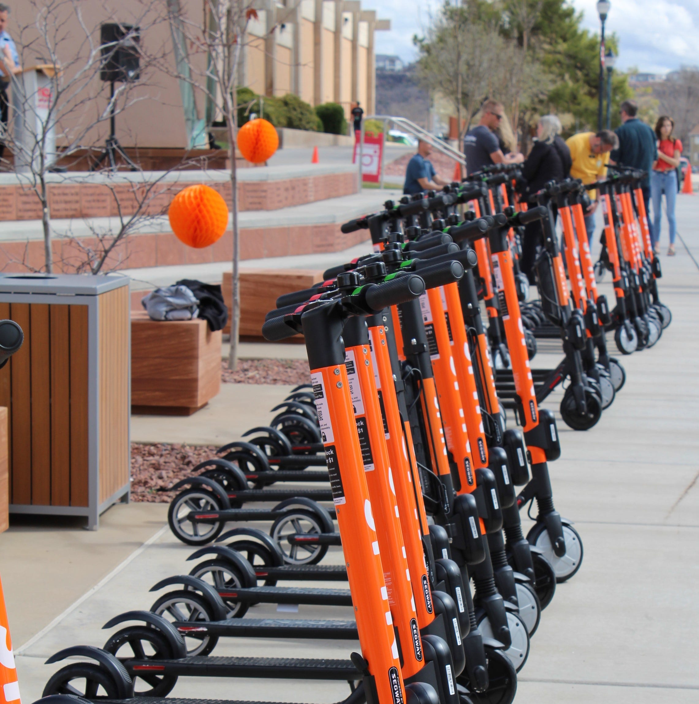 Spin unveils e-scooters to St. George with Dixie State campus ceremony