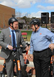 DSU President Richard Williams and St. George Mayor Jon Pike talk scooter strategy before taking a spin around campus Thursday March 7, 2019.