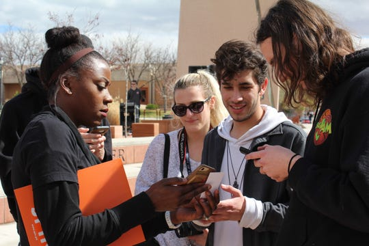 Alysia Montano walks students through the download process for the Spin e-scooter app at DSU Thursday March 7, 2019. Montano serves as the company's marketing and events director.