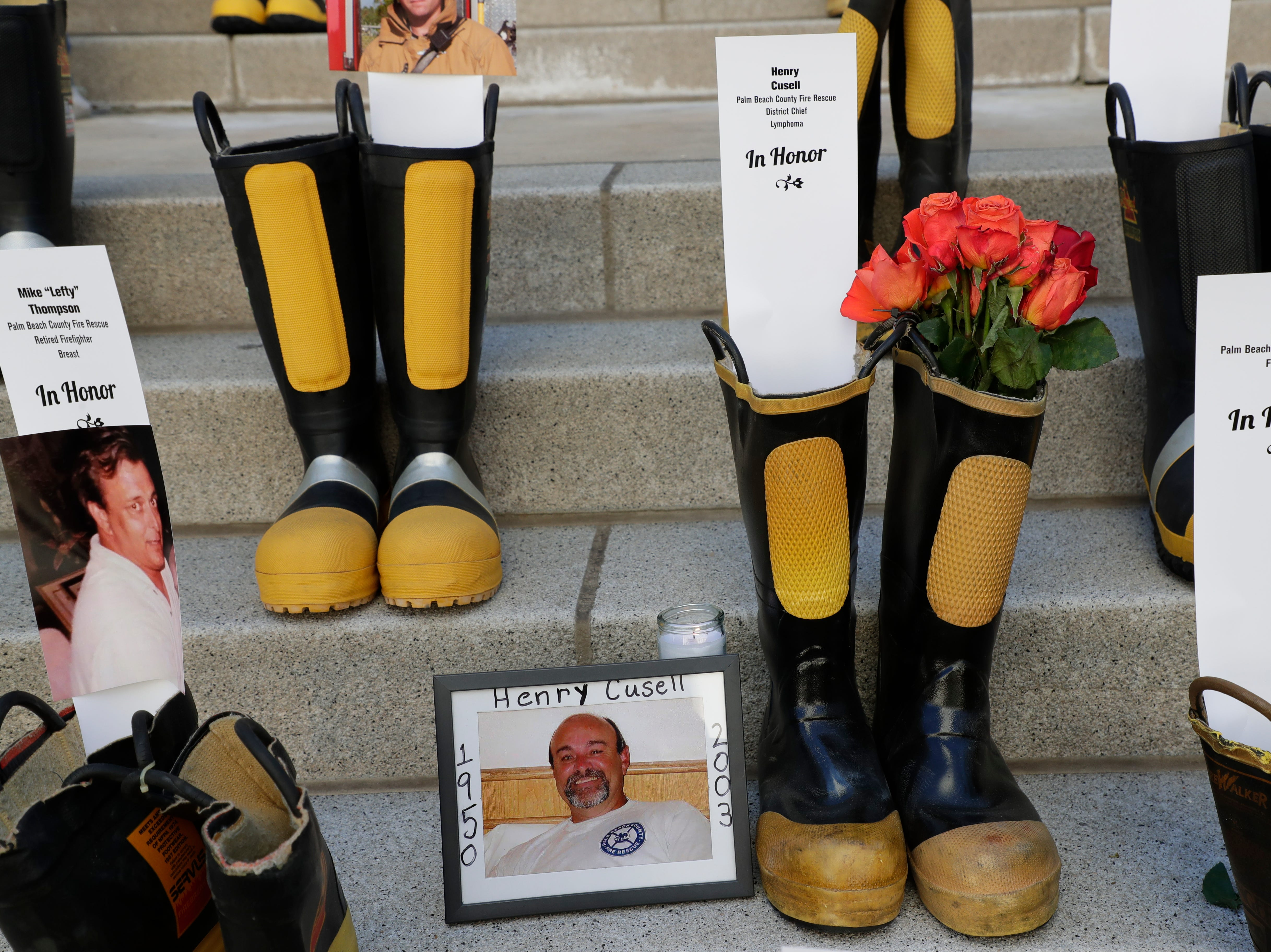 A pair of boots honoring Henry Cusell, a former firefighter who battled Non-Hodgkins lymphoma. Firefighters and their families from around the state create a display at the Capitol of 500 pairs of boots in honor of firefighters who lost their battle or are battling with cancer caused from smoke inhalation and carcinogens Thursday, March 7, 2019. The state of Florida is one of five states in the country that does not have a bill acknowledging cancer is a job-related illness.