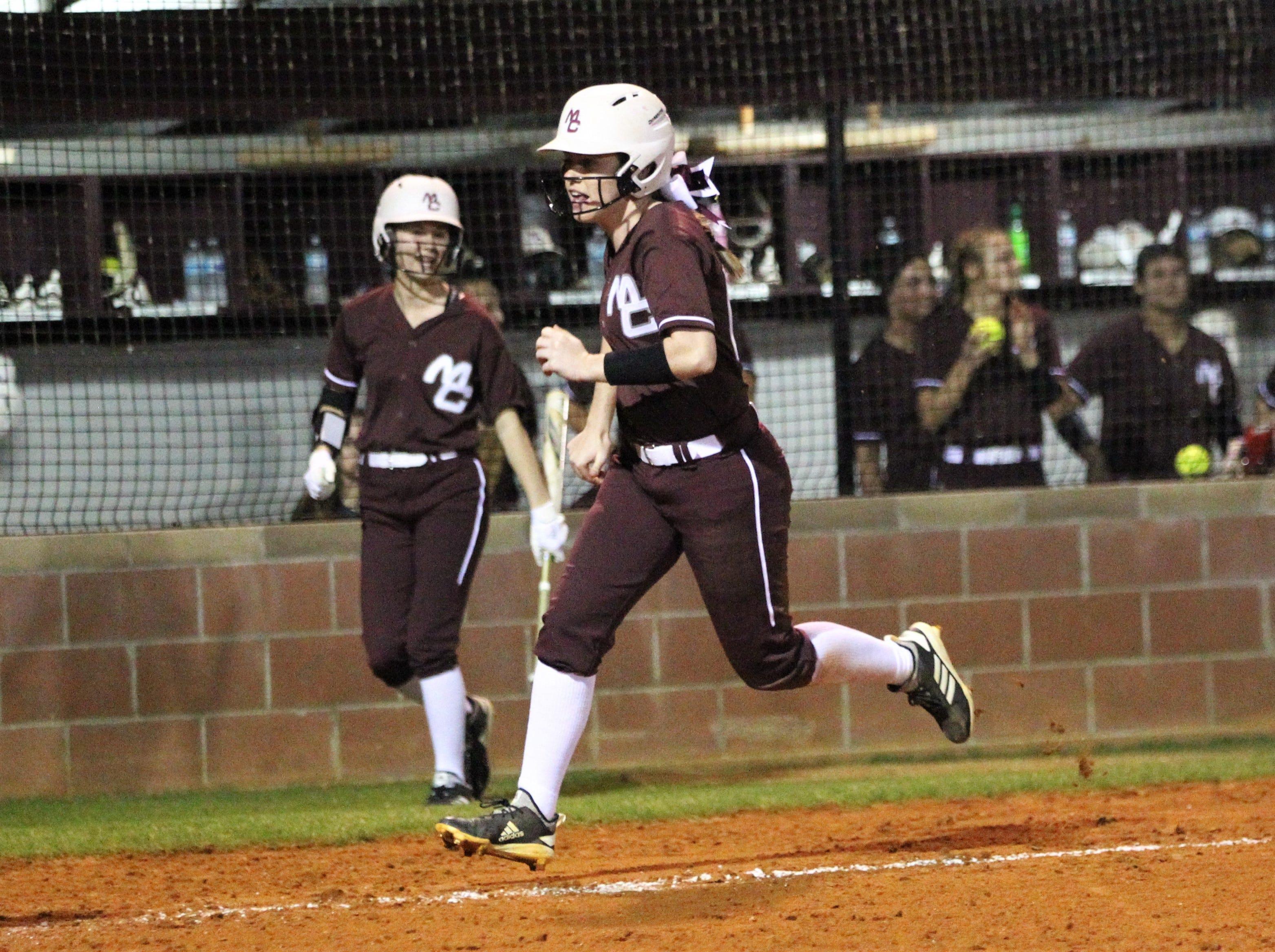Madison County's Gracie Galbraith scores a run as the Cowgirls' softball team beat Suwannee 17-0 on Feb. 28, 2019.