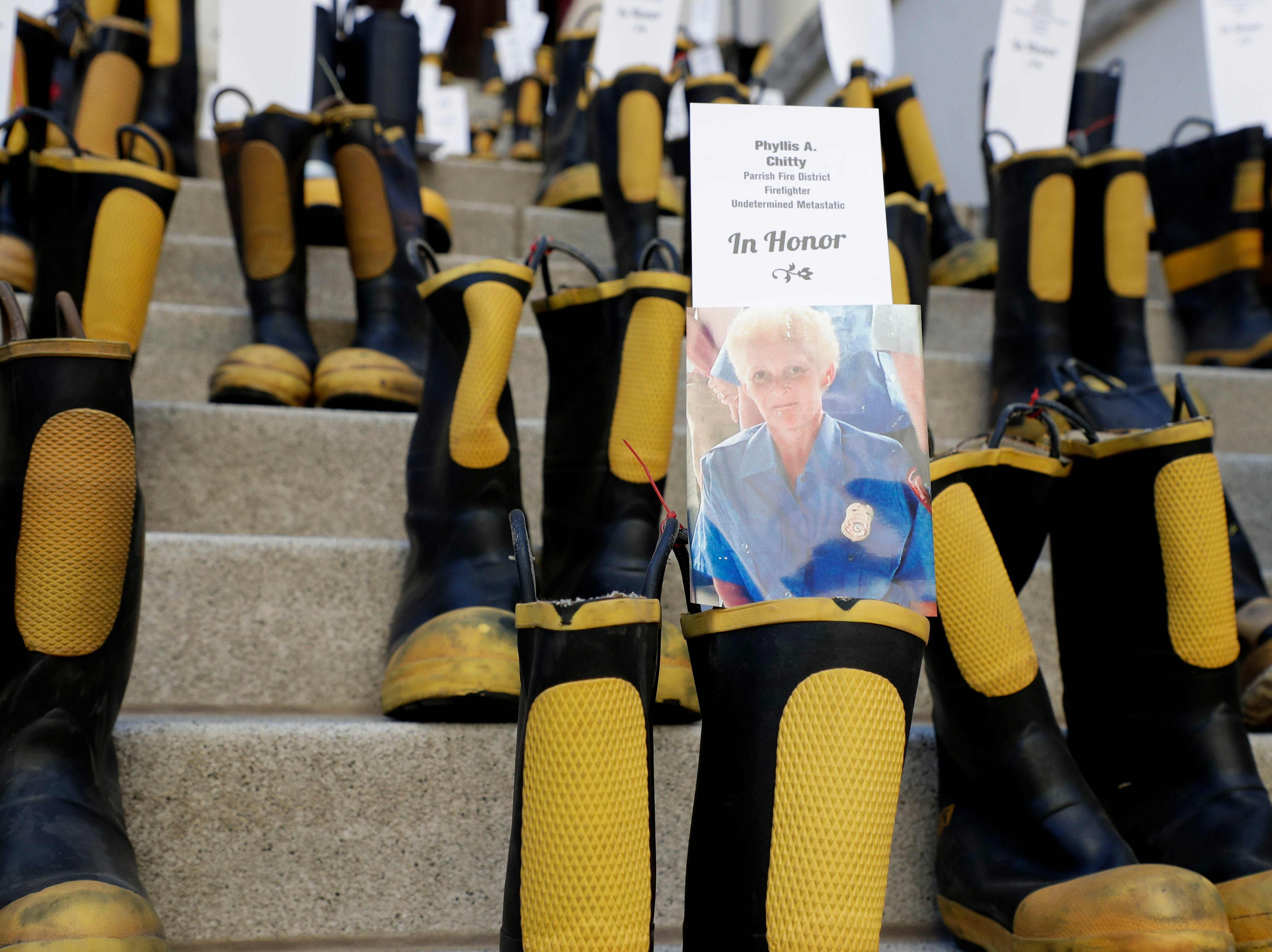 A pair of boots honoring Phyllis Chitty, a former firefighter with the Parish Fire District who battled undetermined metastatic cancer. Firefighters and their families from around the state create a display at the Capitol of 500 pairs of boots in honor of firefighters who lost their battle or are battling with cancer caused from smoke inhalation and carcinogens Thursday, March 7, 2019. The state of Florida is one of five states in the country that does not have a bill acknowledging cancer is a job-related illness.