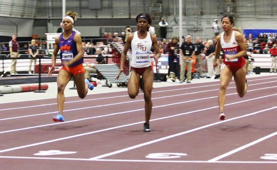 Florida State sophomore sprinter Ka'Tia Seymour (center) enters the NCAA Indoor Track & Field Championship ranked seventh in the 60-meter dash.