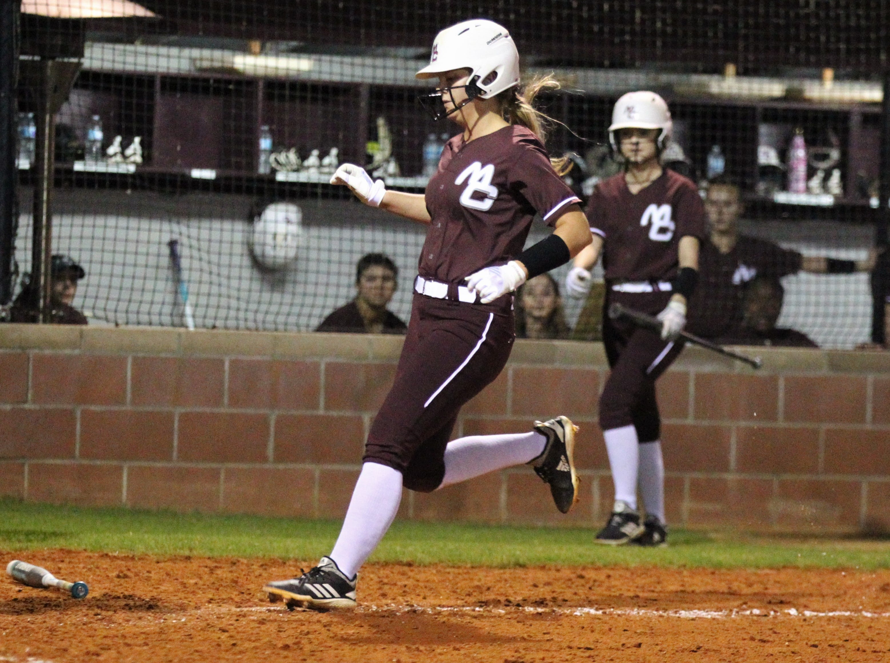 Madison County's Abi Annett scores a run as the Cowgirls' softball team beat Suwannee 17-0 on Feb. 28, 2019.
