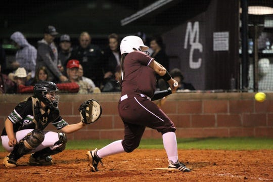 Madison County's Jocelyn Davis bats as the Cowgirls' softball team beat Suwannee 17-0 on Feb. 28, 2019.
