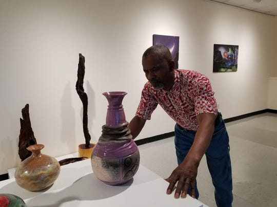 "Earl Washington, who has display of ceramics in the Foster Tanner Gallery, says, ""In every Raku firing you will never get the same effect because you're dealing with different atmospheric environments."""