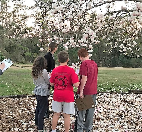 4-H youth taking notes on the sights and smells of the garden. Photo by Allison Leo.