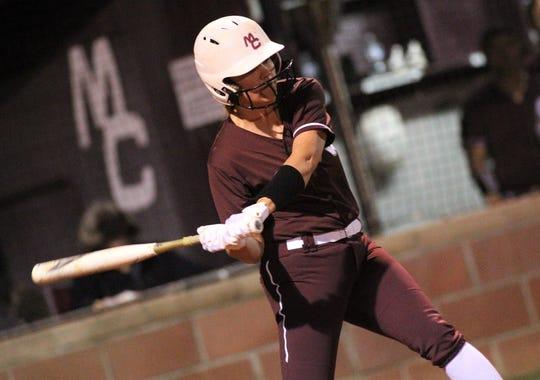 Madison County's Abi Annett bats as the Cowgirls' softball team beat Suwannee 17-0 on Feb. 28, 2019.