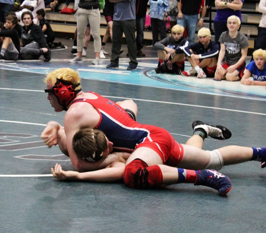 Wakulla's Andrew Annand works to secure a pin for a regional title at 182 pounds at South Walton.