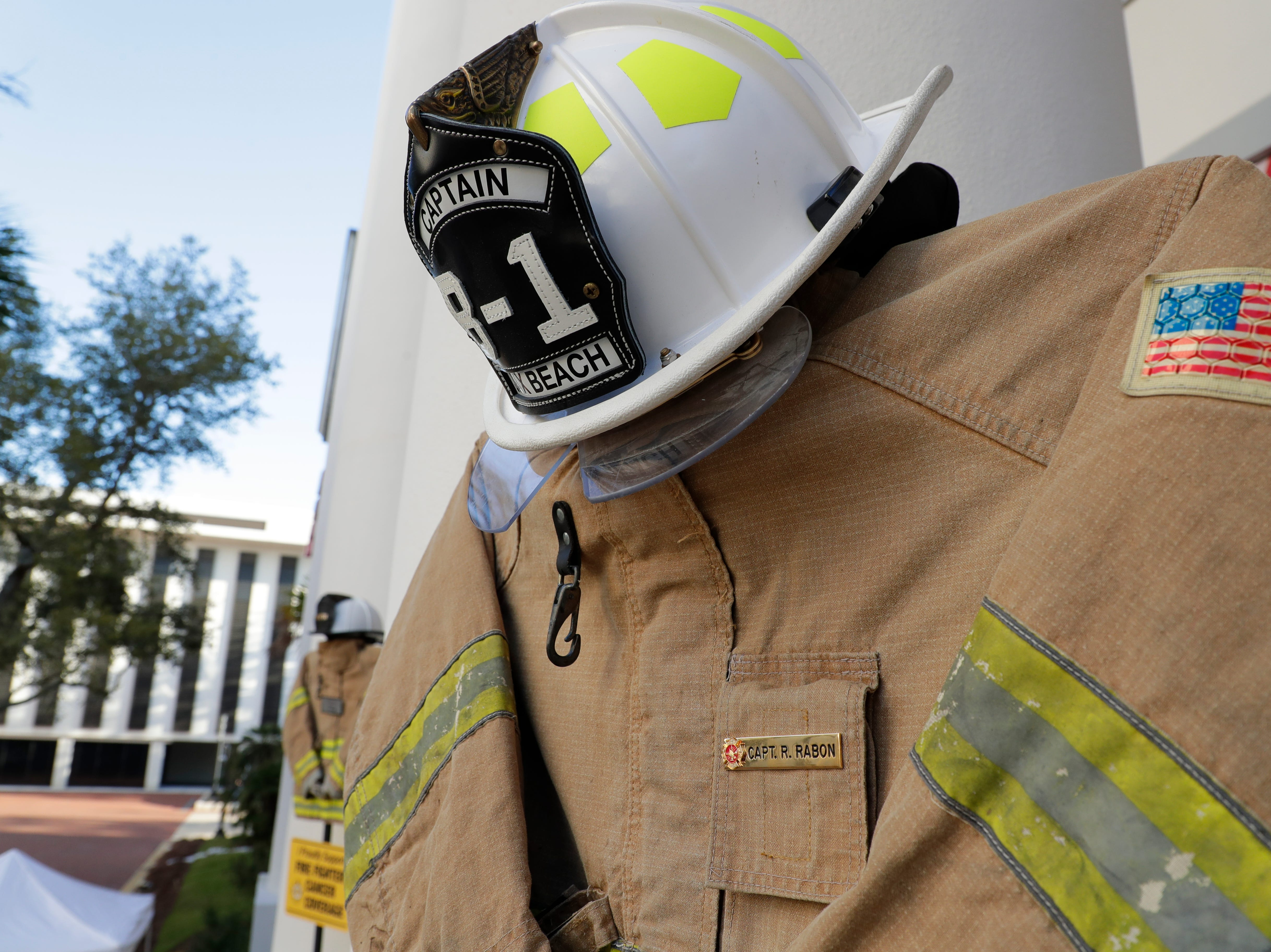The uniform Jacksonville Beach Fire Department Captain Ronald Rabon wore. Rabon battled appendix cancer and passed in Jan. 2018. Firefighters and their families from around the state create a display at the Capitol of 500 pairs of boots in honor of firefighters who lost their battle or are battling with cancer caused from smoke inhalation and carcinogens Thursday, March 7, 2019. The state of Florida is one of five states in the country that does not have a bill acknowledging cancer is a job-related illness.