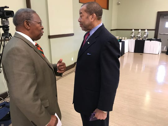 Fred Gainous, left, executive director of the Brooksville Agricultural and Research Station, chats with FAMU trustee Thomas Dortch Jr. at Thursday's meeting.