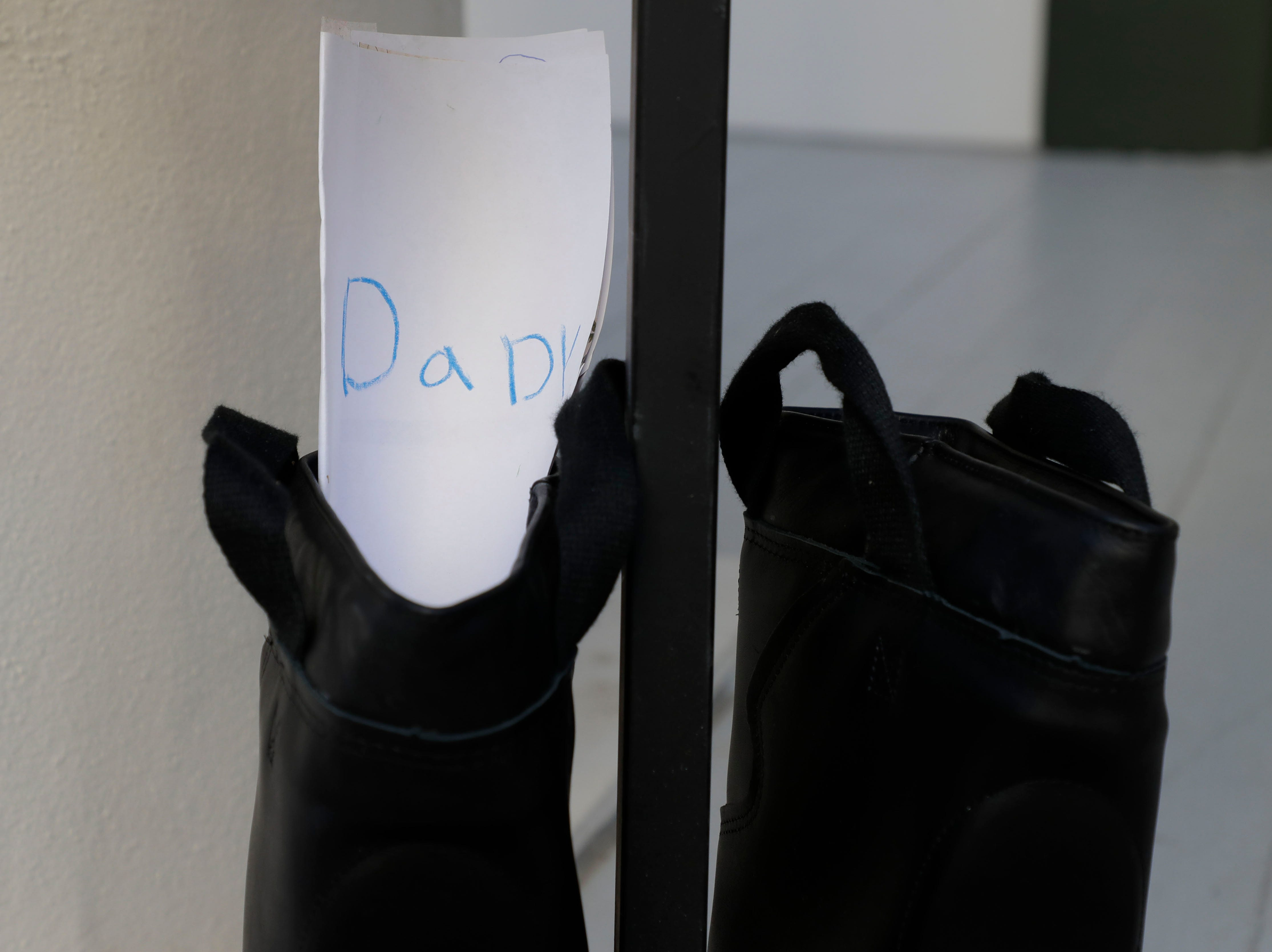 A letter written by Olivia Rabon, 10, tucked into a boot honoring her father who worked with the Jacksonville Beach Fire Department and passed after battling appendix cancer. Firefighters and their families from around the state create a display at the Capitol of 500 pairs of boots in honor of firefighters who lost their battle or are battling with cancer caused from smoke inhalation and carcinogens Thursday, March 7, 2019. The state of Florida is one of five states in the country that does not have a bill acknowledging cancer is a job-related illness.