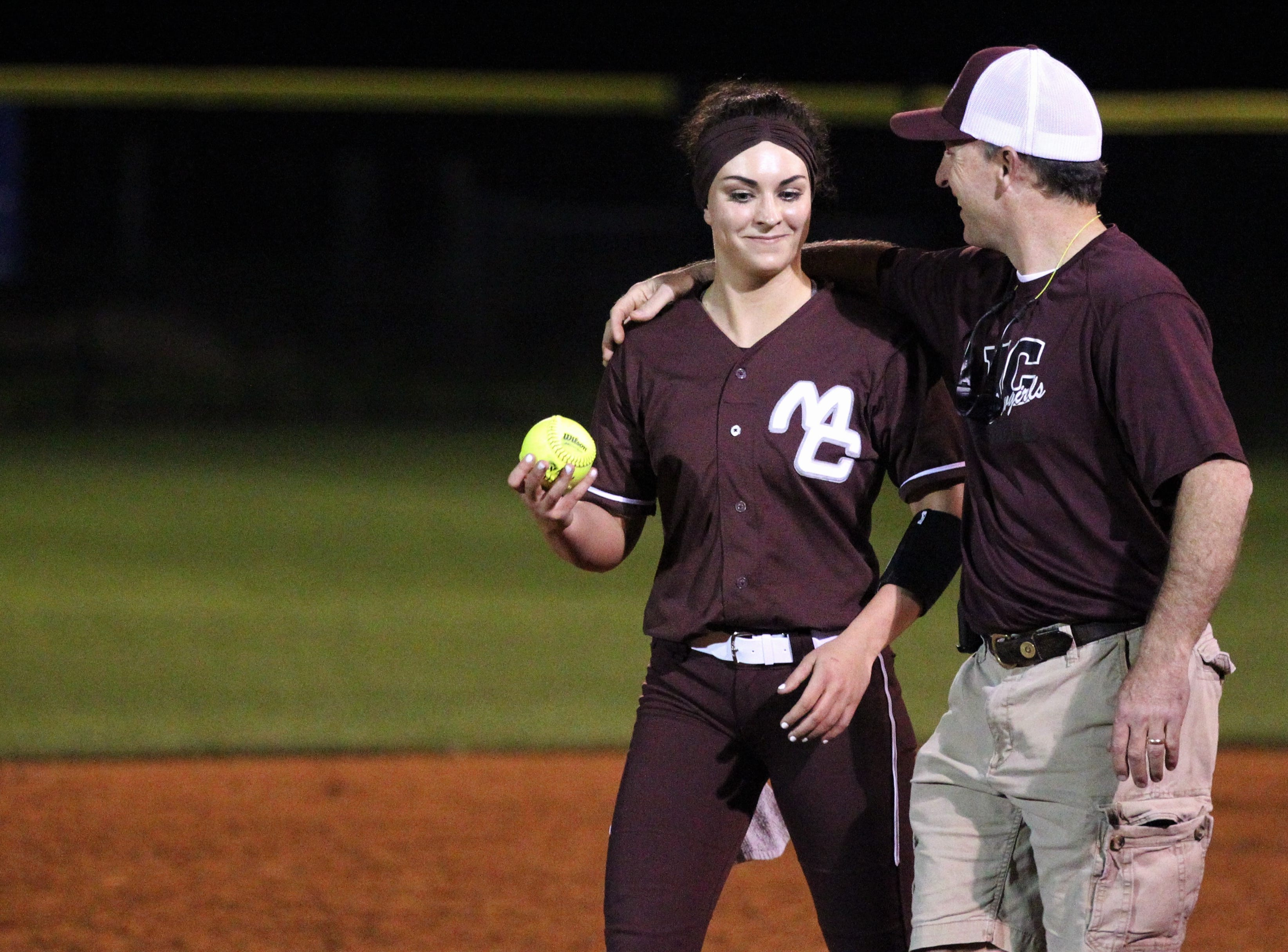 Madison County senior pitcher Reese Rutherford threw a three-inning perfect game with all strikeouts and hit a grand slam home run as the Cowgirls' softball team beat Suwannee 17-0 on Feb. 28, 2019.