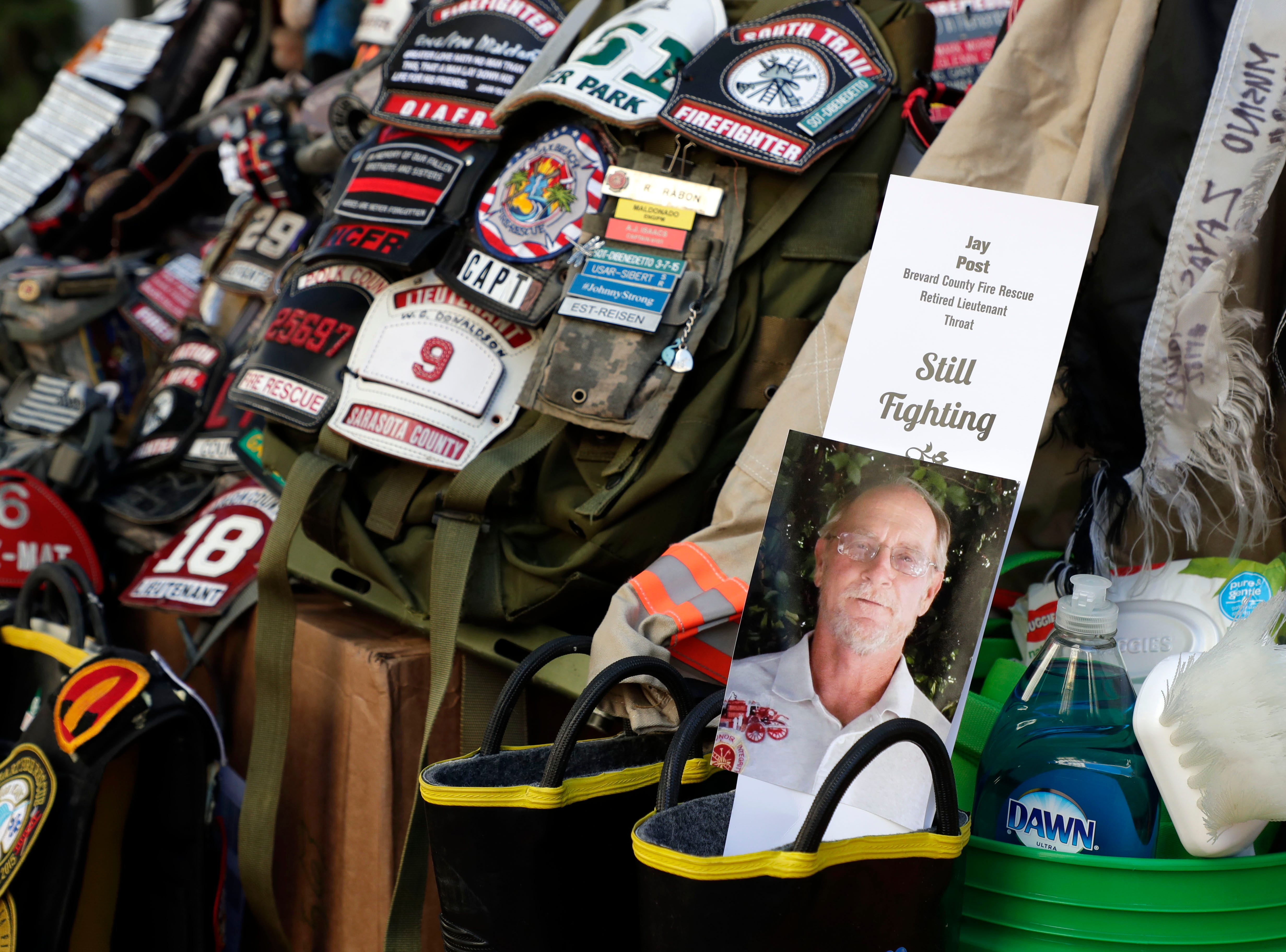 A display honoring Jay Post, a former firefighter who is battling throat cancer. Firefighters and their families from around the state create a display at the Capitol of 500 pairs of boots in honor of firefighters who lost their battle or are battling with cancer caused from smoke inhalation and carcinogens Thursday, March 7, 2019. The state of Florida is one of five states in the country that does not have a bill acknowledging cancer is a job-related illness.