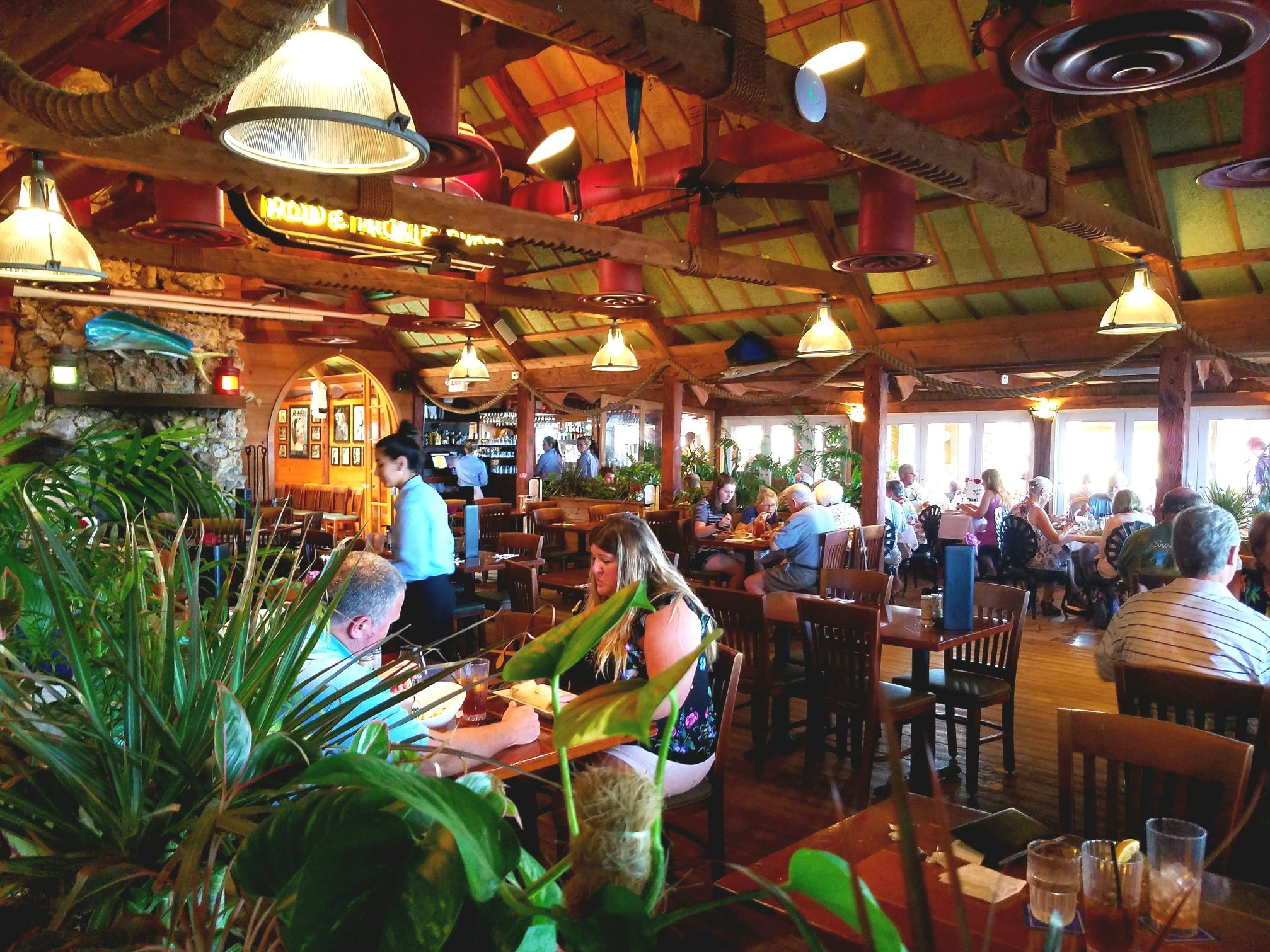 The vibrant tropical setting of the interior dining room is spacious and welcoming.