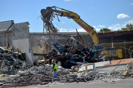 Michael Bean, of AlliedBean Demolition Contractors, of Fort Lauderdale, looks for recyclables to sort as a crane operator continues to demolish the 31-year-old Publix store at Taylor Creek Commons in the 1800 block of U.S. Highway 1, on Thursday, March 7, 2019, in Fort Pierce. The demolished 32,000-square-foot store will be replaced by a new 46,000-square-foot store that is more in line with modern Publix standards.