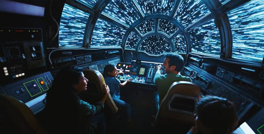This rendering released by Disney and Lucasfilm shows people on the planned Inside Millennium Falcon: Smugglers Run attraction, part of Star Wars: Galaxy's Edge a 14-acre area set to open this summer at the Disneyland Resort in Anaheim, California, then in the fall at Disney's Hollywood Studios in Orlando.