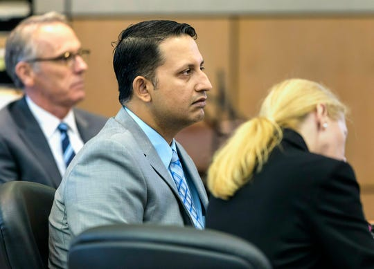 Nouman Raja sits between defense attorney Scott Richardson, left, and paralegal Debi Stratton as attorney Richard Lubin gives his closing arguments in Raja's trial, Wednesday, March 6, 2019 in West Palm Beach.