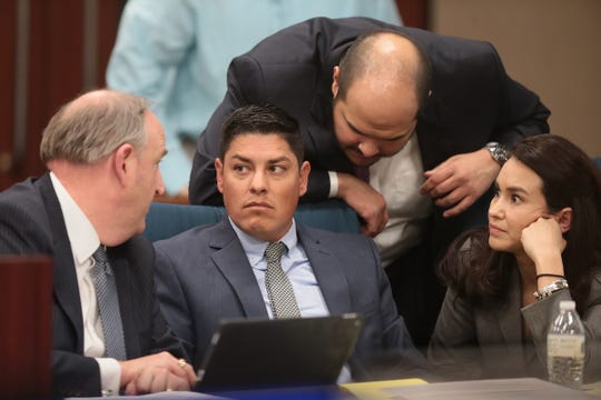 Leonel Hernandez, second from left, huddles with his attorneys during his murder trial in the death of DJ Rick Madrigal in the 168th District Court with Judge Marcos Lizarraga presiding.