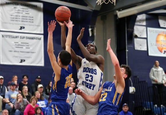 Dobbs Ferry's Damani Fraser (23) goes up for a shot against Ellenville during the boys Class B regional semifinal at Poughkeepsie High School March 6, 2019. Dobbs Ferry won the game 65-48.