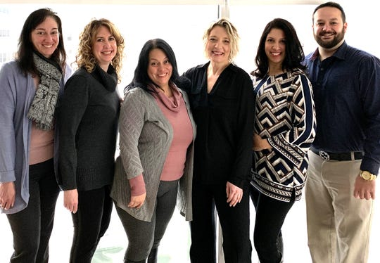 Houlihan Lawrence Global Business Development Team, from left, Mary Jo Lockyer, Jennifer Capaccio, Carol Dorado, Christin Simon Ogryzlo, Delihla Rivera and Christopher Cassis
