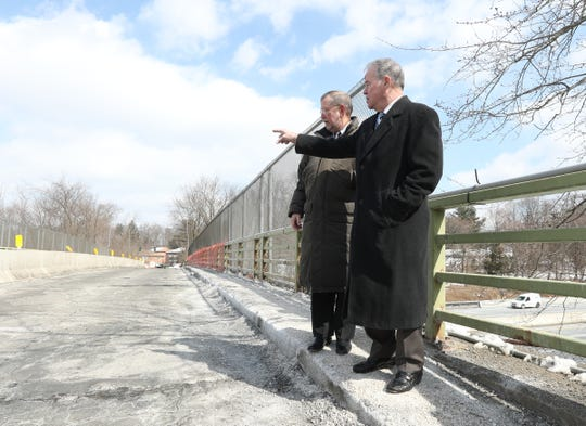 """Rockland County Executive Ed Day, right, and Superintendent of Highways Charles """"Skip"""" Vezzetti, survey the Hungry Hollow Road overpass in Chestnut Ridge on Thursday, March 7, 2019."""