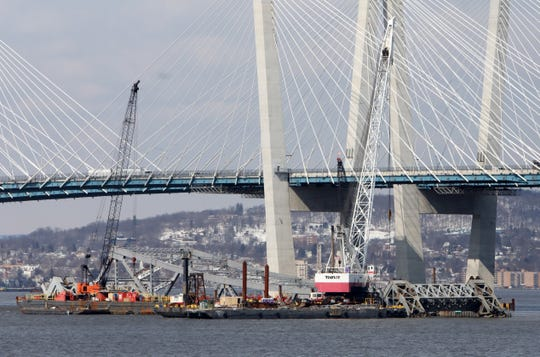 Cranes are used to dismantle the Tappan Zee Bridge in the Hudson River March 7, 2019 as seen from Tarrytown.