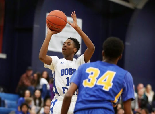 Dobbs Ferry's Lester McCarthy (12) drives to the basket against Ellenville during the boys Class B regional semifinal at Poughkeepsie High School March 6, 2019.