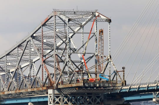 Workers atop cranes dismantle the Tappan Zee Bridge March 7, 2019 as seen from Tarrytown.