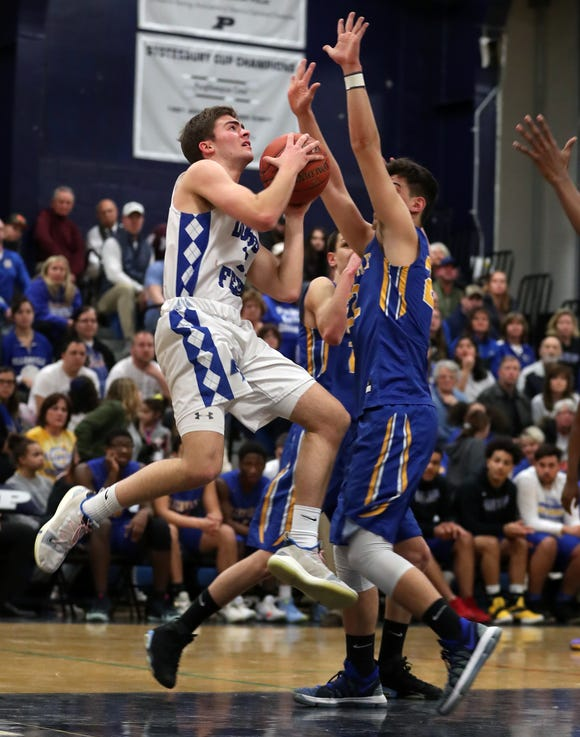 Dobbs Ferry's Zach Holzman (15) drives to the basket against Ellenville during the boys Class B regional semifinal at Poughkeepsie High School March 6, 2019. Dobbs Ferry won the game 65-48.