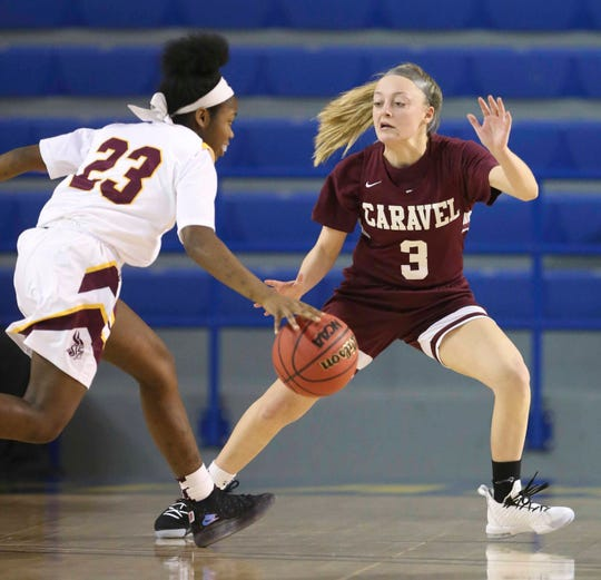 St. Elizabeth's Ber'Nyah Ward-Mayo (23) is defended by Caravel's Karli Cauley in the second half of Caravel's 67-58 win in a DIAA state tournament semifinal at the Bob Carpenter Center Wednesday.