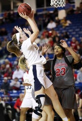 Sanford's Allie Kubek puts a rebound back against Conrad's Ja'Nylah Whittlesey in the first half of a DIAA state tournament semifinal at the Bob Carpenter Center Wednesday.
