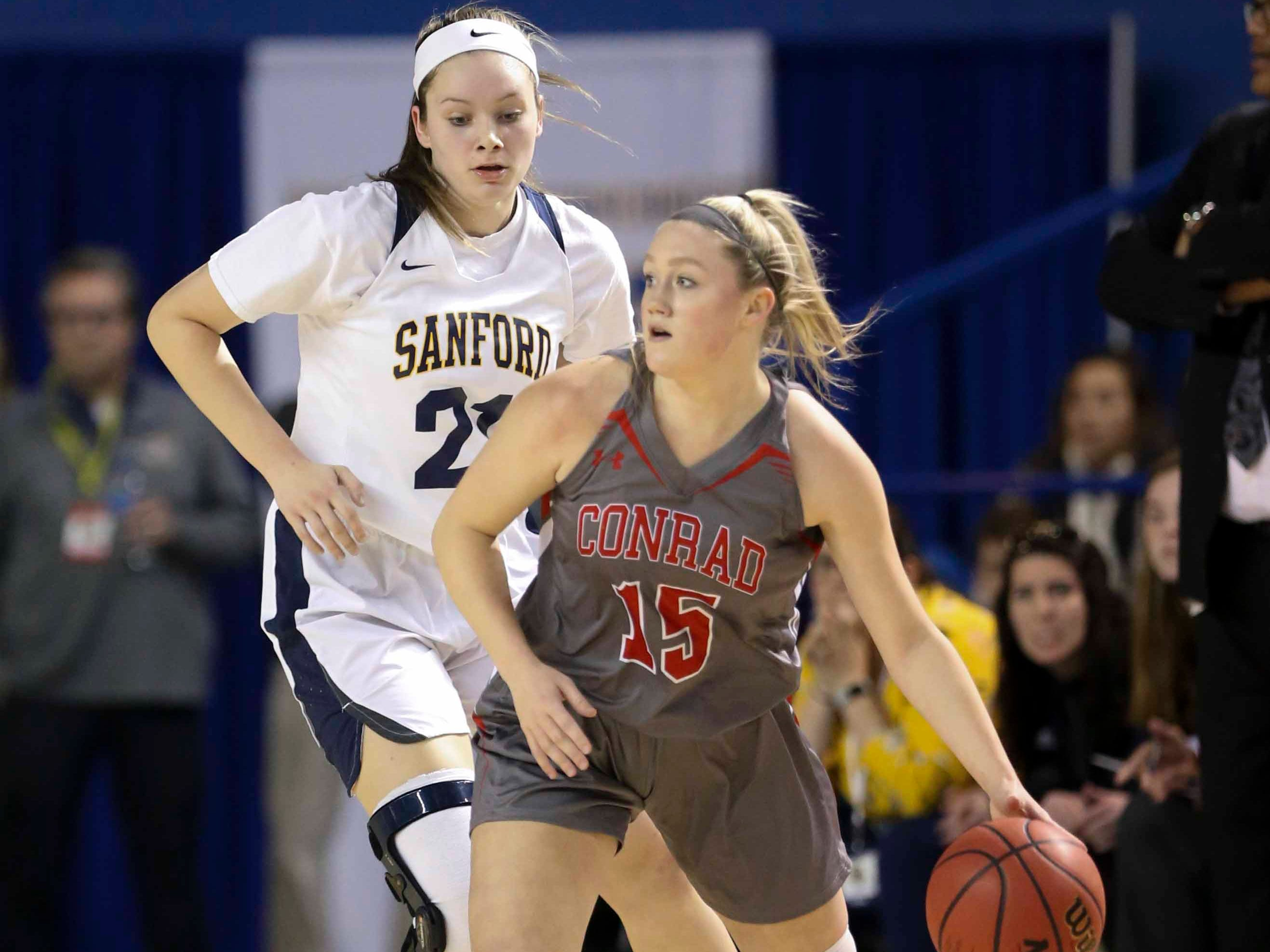 Conrad's Jordan Rook (front) is guarded by Sanford's Allie Kubek in the first half of a DIAA state tournament semifinal at the Bob Carpenter Center Wednesday.